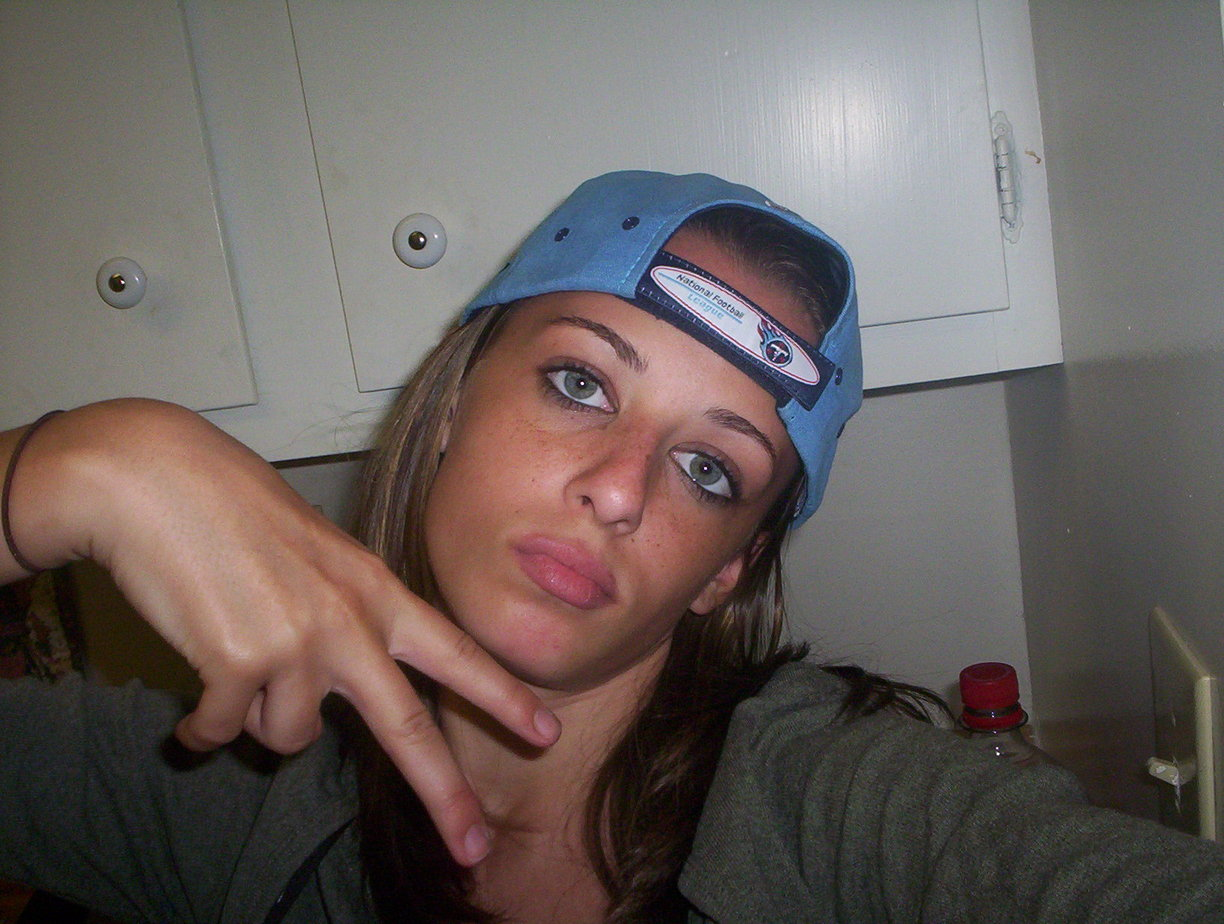 Cute Teen Girl Giving the Peace Sign